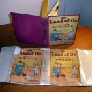 Land of Oz.  Later state with 12 color plates and dust jacket