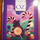 Toto in candy Land of Oz. by Roger Baum (signed copy). 2002. Hardcover
