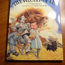 Wizard of OZ. Hardcover. Illustrated by C. Santore( signed). Hardcover in Dj....