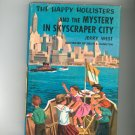 Vintage The Happy Hollisters And The Mystery In Skyscraper City Jerry West Hard Cover Dust Jacket
