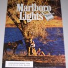 1995 Marlboro Cigarettes Lake Side Camp Western Scene Color Print Ad