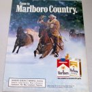 1986 Marlboro Cigarettes Cowboy Winter Themed Color Tobacco Ad