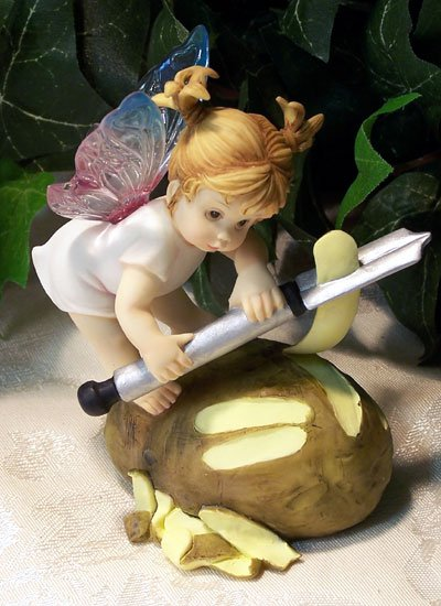Kitchen Fairy Peeling Potato