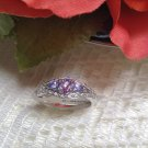 0.50ctw Oval & Pear Shape Tanzanite With .14ctw Round White Zircon .925 SS Sz 8