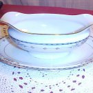 Noritake Wellesley gravy boat with attached plate and gold trim