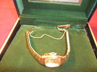 VINTAGE LADIES' WITTNAUER 10 KT YELLOW GOLD PLATED DIAMOND WRISTWATCH