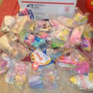 Large priority box filled with Barbie happy meal toys
