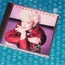 Lorrie Morgan  Something in Red       755174592027    (820)
