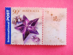 Australian International Postage Stamp holiday theme with a purple star and gift packages