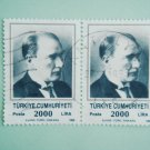 2 Turkish Postage Stamps with the first President Mustafa Kemal Ataturk on it in green tones