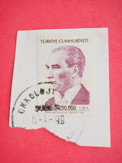Partial Envelope with a Turkish Postage Stamp and Ink Postmark on it