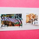 Two United States Postage Stamps Greetings from Georgia and Red Fox