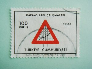 Turkish Postage Stamp symbolizing developments in highways and road pavement