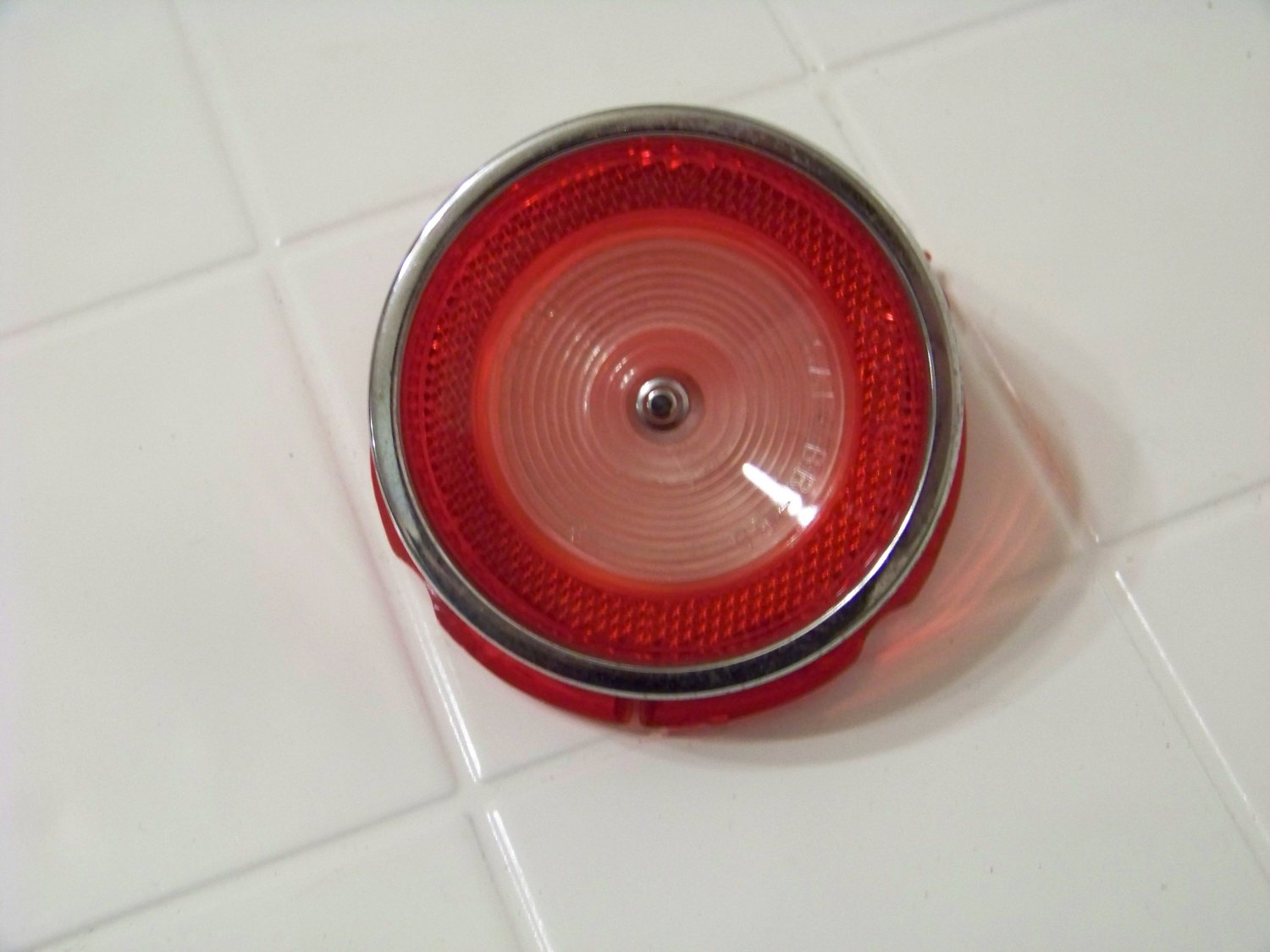 1965 Chevrolet Chevy biscayne back up lens  glo-brite t-6311 sae br 65 with trim