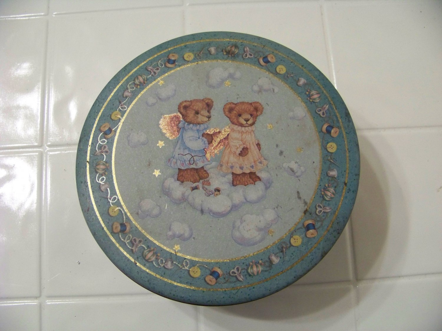 vintage sewing tin with angel bears buttons thread needles