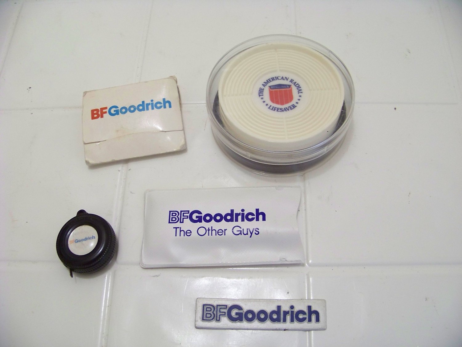 B.F. Goodrich advertising tire tape measure key chain magnet coasters golf tee rain hood