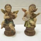 pair of angels one with harp one with horn made in Japan
