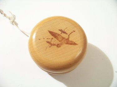 wood yo yo with geese on side toy yoyo