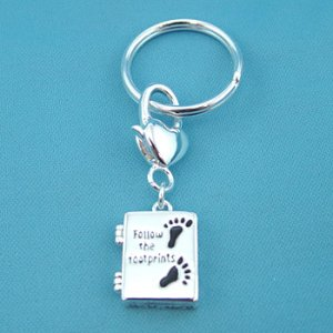 """FOOTPRINTS""  KEYCHAIN"