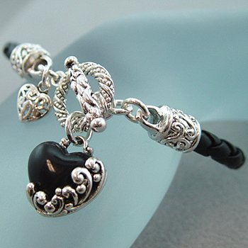 SILVER ACCENTED BRAIDED BAND with BLACK ONYX HEART DANGLE