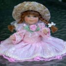 Porcelain Doll  Braids and Pink dress