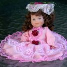 Porcelain Doll - dressed in  pink.