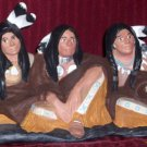 Native Male Sitting Trio