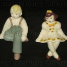 Mid Century Porcelain Farm Boy and Girl Shelf Sitter Figurines