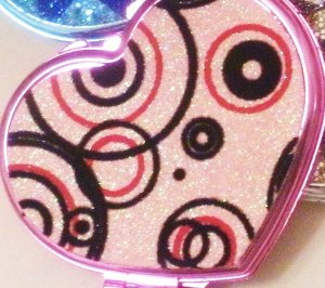 Pink Mirror with black swirls