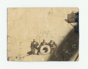 Photo of 3 sailors on U.S.S. Milwaukee