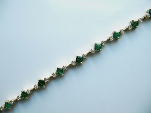 Gold Bracelet with Emeralds and Diamonds