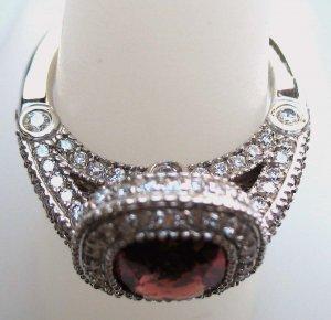 Sunstone Ring with Elegant Diamond Setting