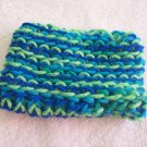 Hand-knitted doll hat, blue and green