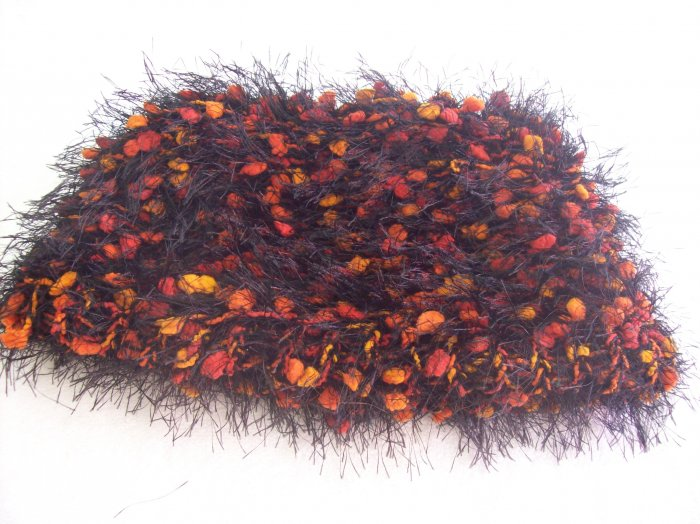 Hand-knitted ladies hat, black with orange