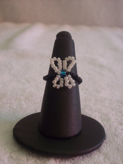 Butterfly ring, white on black