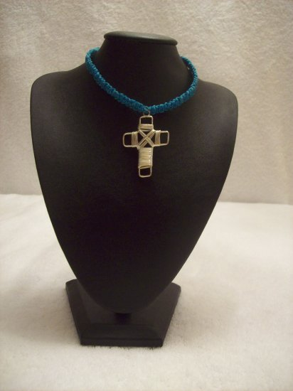 Silver wire cross on royal blue square