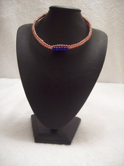 Blue beads (6, strung on) on red and white square