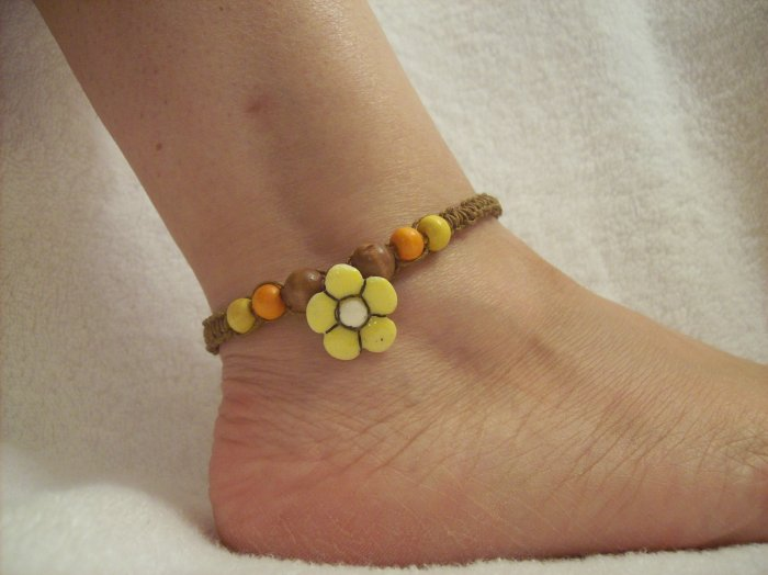 Yellow flower with wood beads on brown square