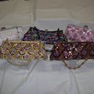 "female sequin/beaded evening purse,red,green,royal,green pink bk, 5"" x 9"", has chain/beaded strap"