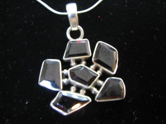 Classic design with garnet stones.