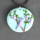Lavender Bird Against a Blue Sky Pendant