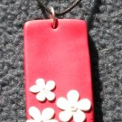 Red and white daisy pendant