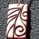 Pink and black swirl pendant