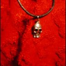 SILVER-TONED SKULL CHARM ON CORD