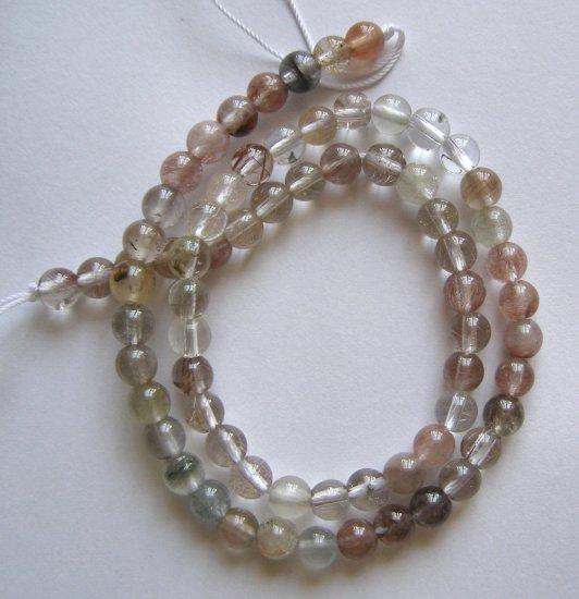"Rutilated Quartz 6mm Round Beads 16"" strand"
