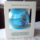 Season for Caring Blue Satin 1982 Hallmark Ornament