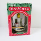 Noma Ornamotion Christmas Mouse writing to Santa Ornament Mouse on Candle