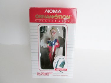 Noma Ornamotion Angel Choir Boy Rotating Christmas Ornament Red Gown and White w Blue Wings