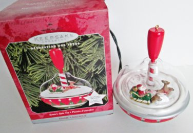 Hallmark 1998 Santa's Spin Top Magic Ornament Motion Colorful Spins with Sleigh and Reindeer