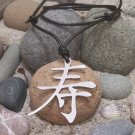 Longevity in Kanji, stainless steel pendant on natural leather cord. A surfer style necklace
